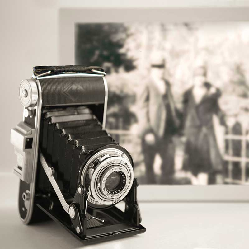 Old camera and photo
